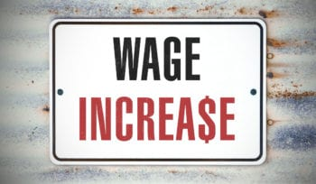 """A sign that says """"WAGE INCREASE."""""""